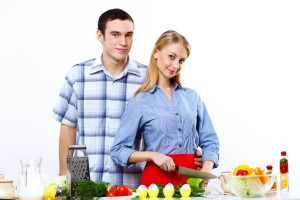 2726425 husband and wife together coooking at home
