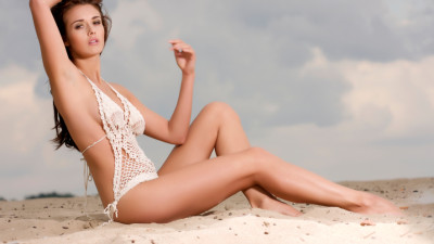 4239135 young fashion pretty sexy woman on the beach