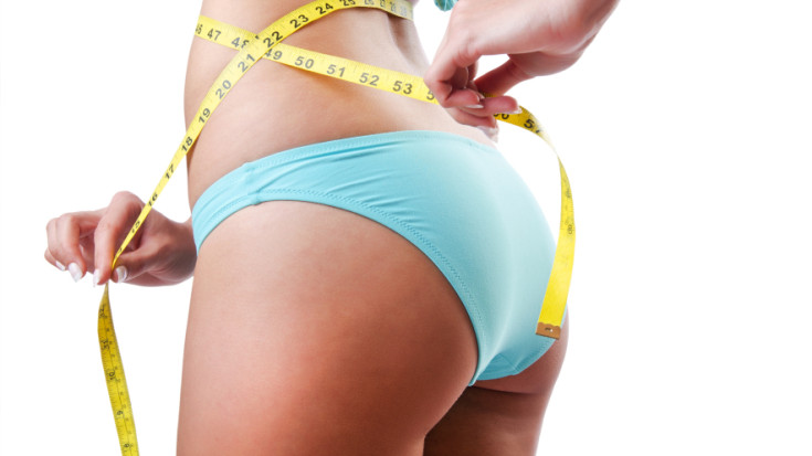 25513867 Young lady with centimetr in weight loss concept